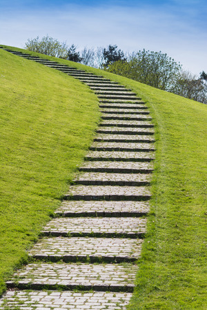 uphill: Springtime - Picture of a stair uphill made by natural stones Stock Photo