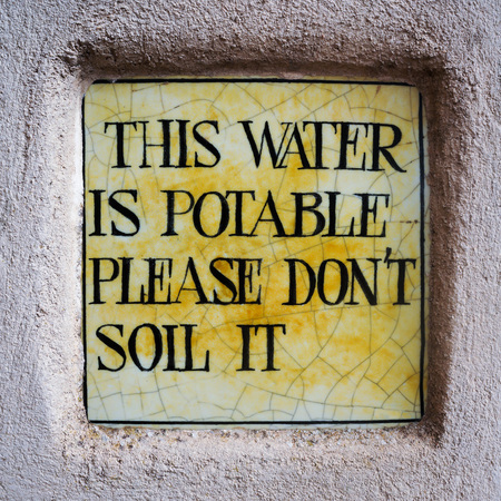 potable: Small sign about potable Water Stock Photo