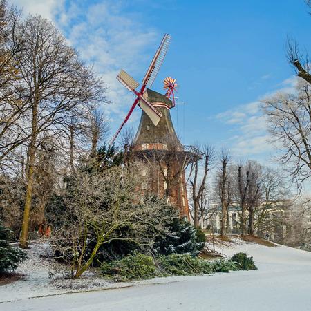 impressive historic windmill at bremen - in winter sunlight Stock Photo