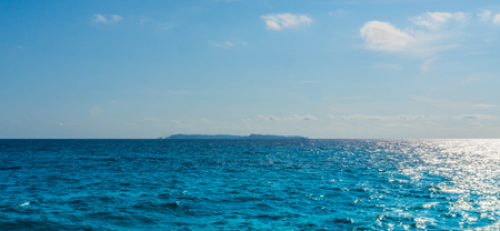 picture of isla caprera at mallorca - done from the beach impressive view with water, waves and little bit of dust