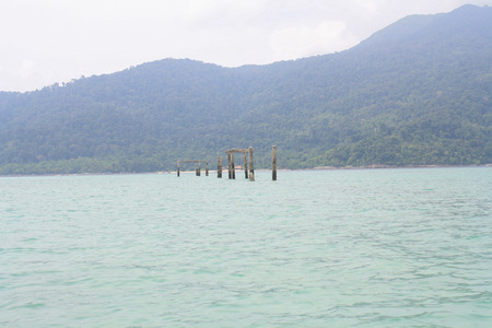 pilings: Pillars in the sea Stock Photo