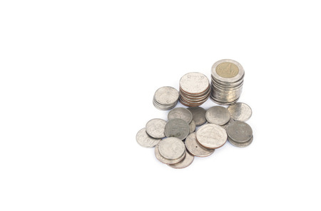 indices: THB Thailand stack of coins sorted in order from bottom to top. White background, space on the left. Stock Photo