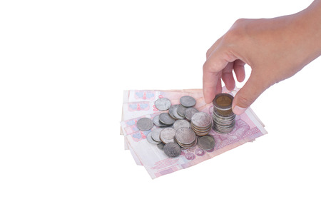 indices: Thailand coins and banknotes Hand is picking the white background.