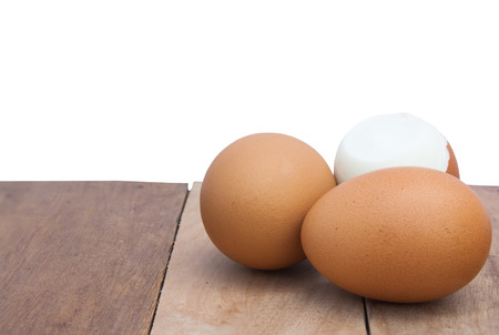 laid back: Still Life-Eggs laid on the old wooden floor and white background peeled eggs laid back.