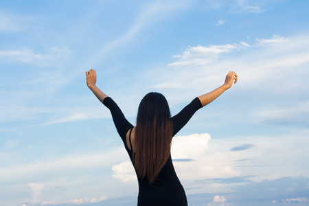 Women with long hair on the back of your arms are two sides to show a happy mood relaxing sky backdrop.