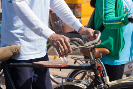 energize: Udon Thani, Thailand, August 16, 2015: bikes for a cycling event at the mother biking together in the streets. Energize the Queen Mother. Handle the hands-down old bicycle, walk, bike, wheelchair forward. Editorial