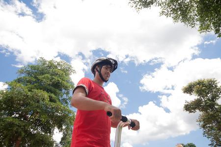 segway: Man wearing a helmet a Segway.