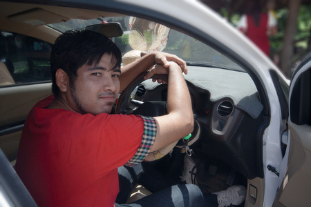forced: A young man sitting behind the steering wheel.