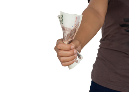 accounts payable: Tightly clutching money in hand, standing next to a white background.