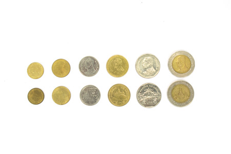 Old silver coins ranged from small to large, on a white background. Stock Photo