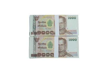 Thailand is a bundle of banknotes piled on a white background. Stock Photo