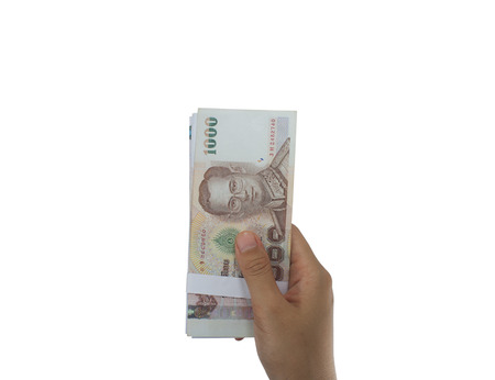 lien: Giving money, money in hand outstretched in front of a white background. Focus on the subject in hand. Stock Photo