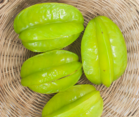 star fruit: Star fruit wicker container. Stock Photo