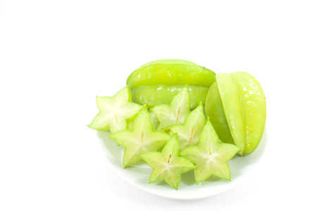star fruit: Star fruit in white container, Isolated white background.