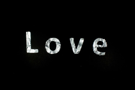 bourne: concept word love Bourne silver isolated black background