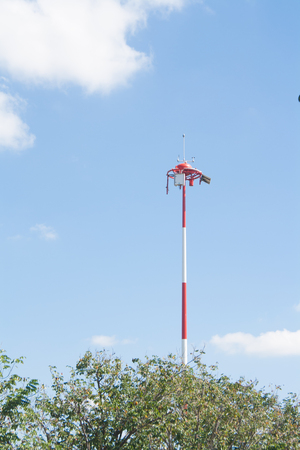 meteorological: Weather in airport antennas, Devices meteorological station on the blue background of the sky Stock Photo