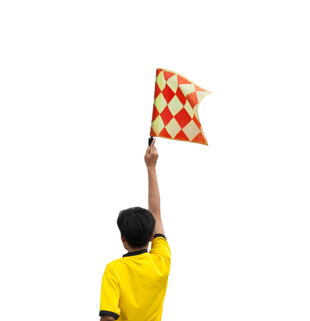 linesman: The back of the linesman flags to signal. Isolated white background