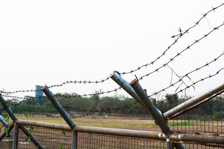 boundaries: Barbed wire protecting the boundaries of airport security. Stock Photo