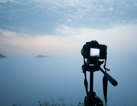 motionless: Installing the camera on a tripod to shoot the sunrise in the morning.