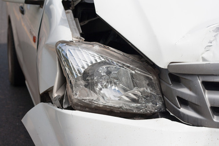 The front of the car damaged in an accident. Automobile White Stok Fotoğraf - 69647184