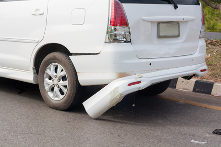 White rear car damage, car accident on the road. Stock Photo