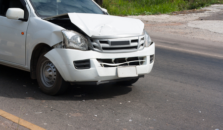The front of the car damaged in an accident. Automobile White. Car accident on the road. Stock Photo