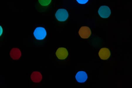 Abstract background of out of focus lights at night. Light hexagon. Stock Photo