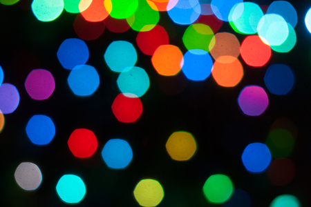 Abstract background of out of focus lights at night. Light hexagon. Imagens