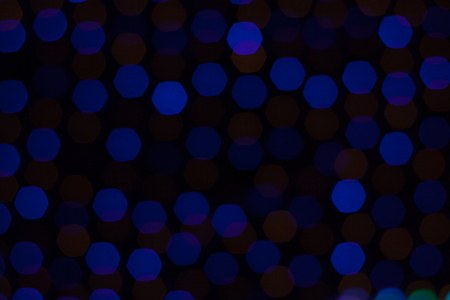 bokeh lights on black background. Abstract background of out of focus night scene.