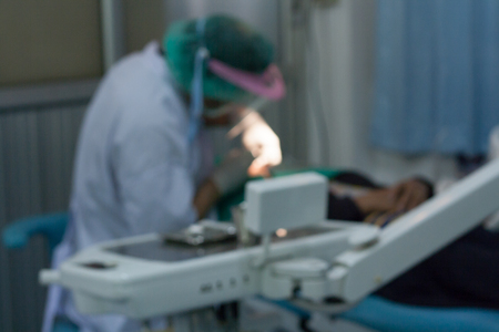 Blurred images, dentists are extracting teeth to patients.