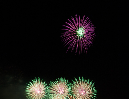 Night Fireworks show scene. Celebrated by a grand fireworks display (copy space).