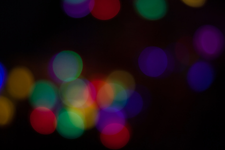 Abstract background of out of focus lights at night. Imagens