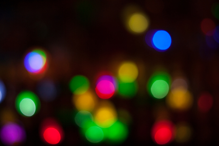 Bokeh shimmering light. Blurred multicolored lights in the darkness. Imagens
