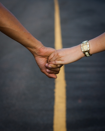 Couple walking hand in hand on the street, travel concept of love. Imagens - 105940914