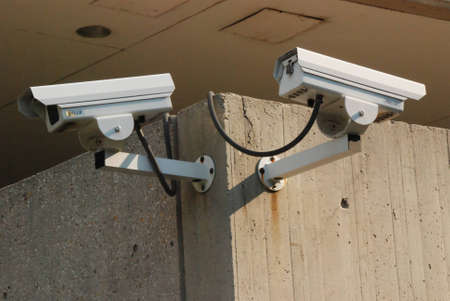 Security Cameras on corner of Building Stock Photo - 1735922