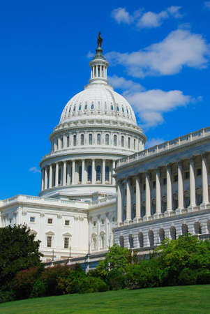 The United States Capitol is the capitol building that serves as the seat of government for the United States Congress, the legislative branch of the U.S. federal government. It is located in Washington, D.C., on top of Capitol Hill at the east end of the Stock Photo