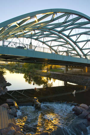 ironworks: The Speer Boulevard Bridge in Denver, Colorado that suspends over the Platte River.