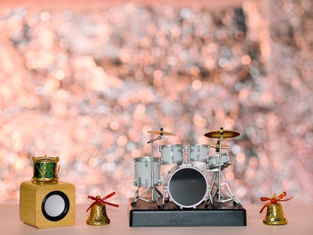 shiny background: Christmas bell with drums shiny background