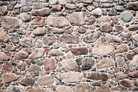 Old wall made of big stones and broken bricks. Vintage rough blocks surface background 免版税图像