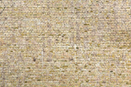 Cracked gray brick wall, blocks in a line background Stock Photo