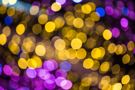 Abstract christmas background with colorful bokeh light effects
