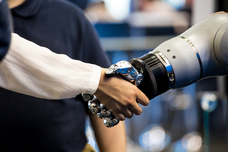 Robot hand shaking human hand Stock Photo - 112653706
