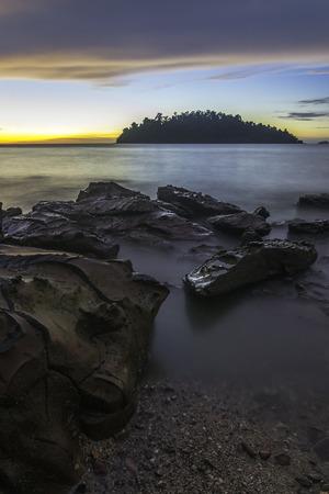 Seascape with rock scenery on sunset / sunrise