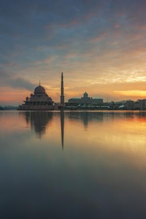 Putrajaya mosque with a nice silky reflection in burning sunset / sunrise