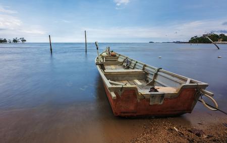 fisherman boat at the beach at noon