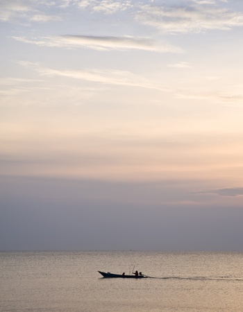 boat on sea and nice of sun set photo