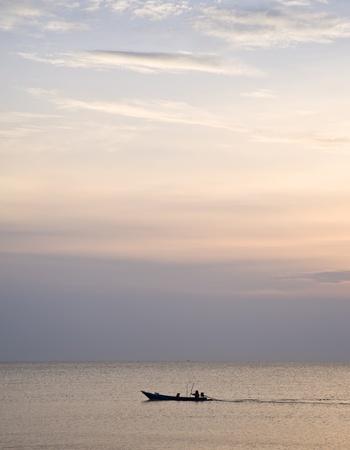 boat on sea and nice of sun set photo