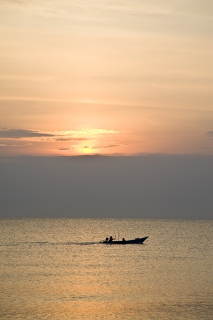 boat on sea and nice of sun set