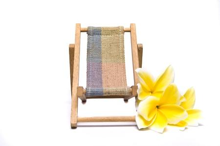 beach chair and plumeria flowers photo