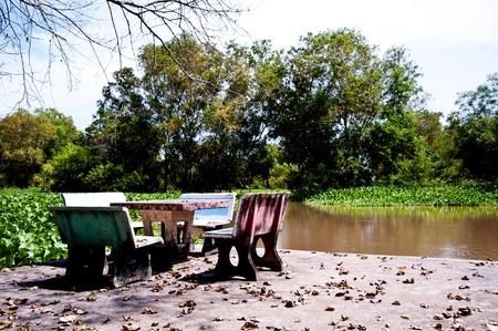 stone chair near the river photo